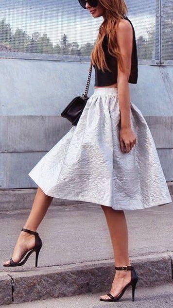 so pretty! love her strappy heels & silver midi skirt!