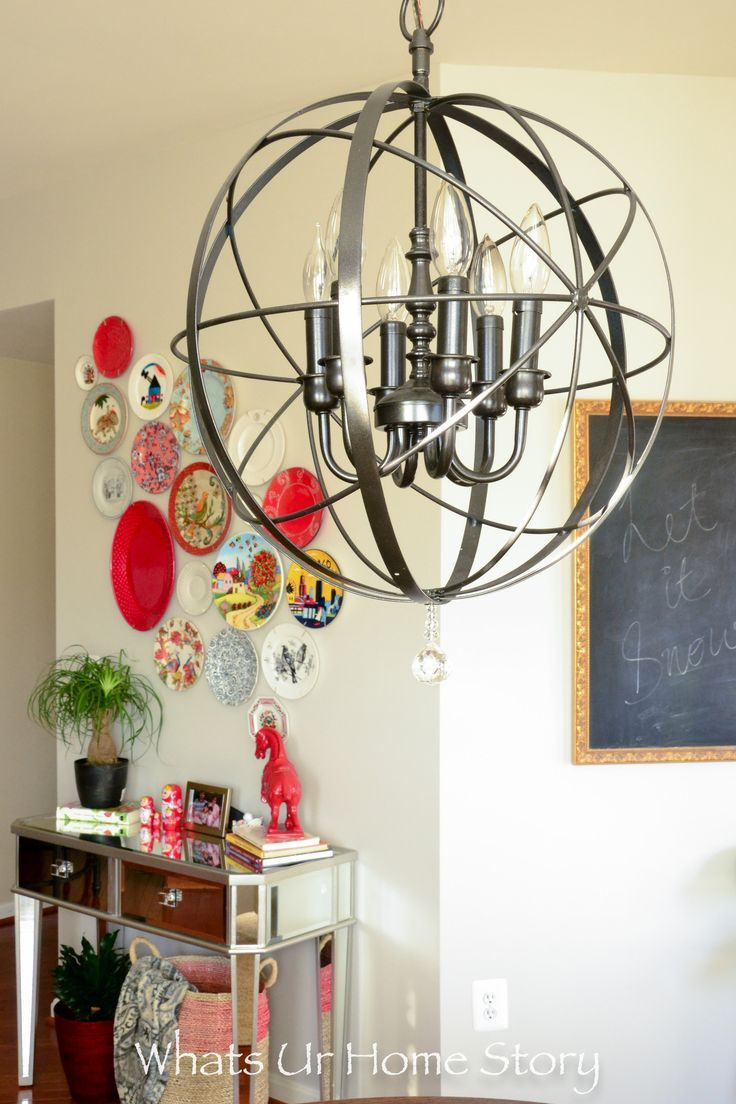 Plate Wall  with red accents over a mirror console table. By the way that orb chandelier is a DIY too.