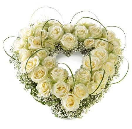 Open mourning heart - roses, baby's breath, bear grass and green material surrounding this heart shape