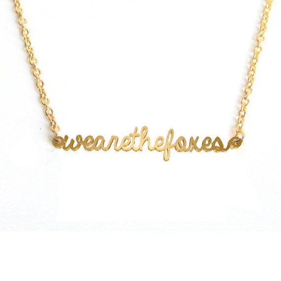 """A """"we are the foxes"""" pendant. 