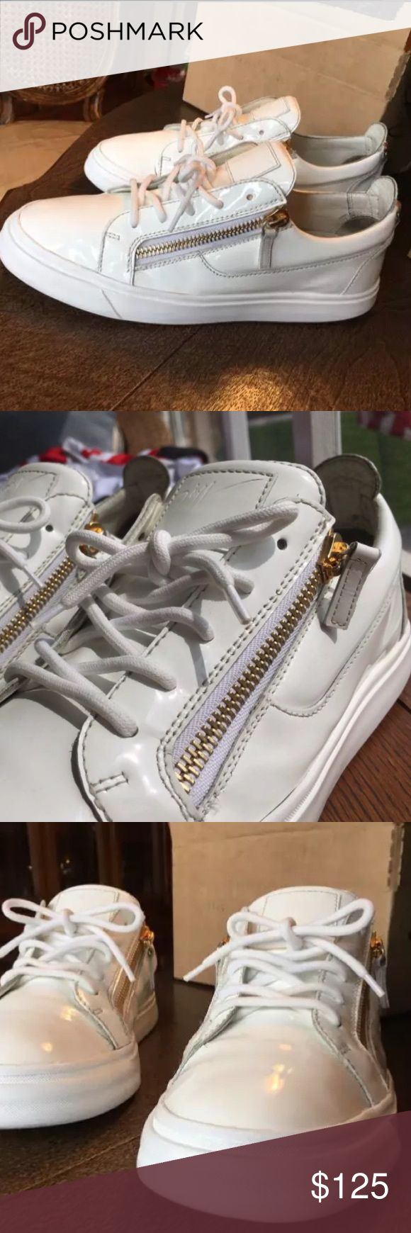 GIUSEPPE ZANOTTI MAY LONDON SNEAKERS EU 42 US 9 Men's white patent leather Giuseppe Zanotti May London round-toe low-top sneakers with gold-tone hardware, embossed logo at tongue, pull tab and faux zipper at counters, rubber soles, zip closures at sides and lace tie closures at uppers Giuseppe Zanotti Shoes Sneakers
