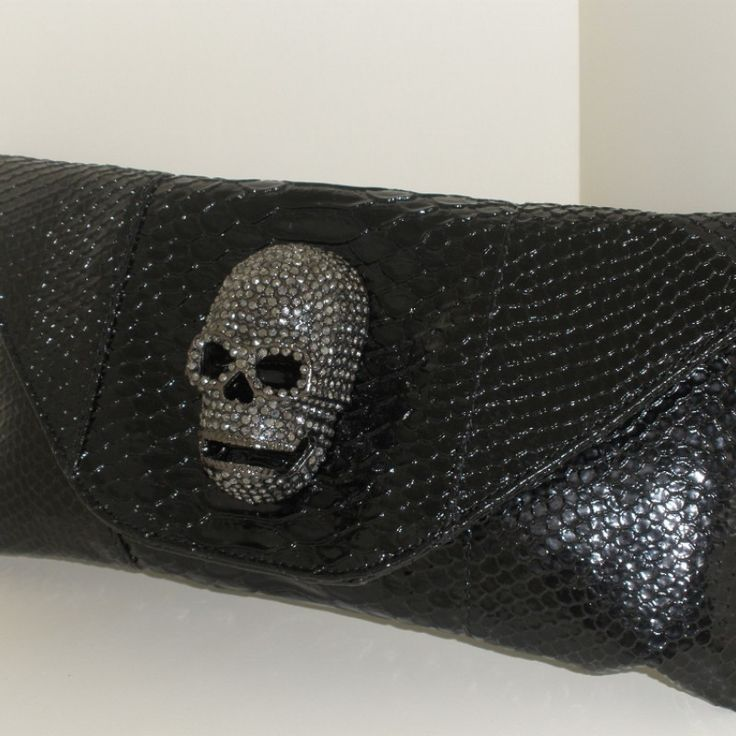 Skull clutch bag  Skull Bag, faux snake print black with amazing solid skull head in antique silver tone. Designer None the Richer, brand new, no tags, long over the shoulder strap or clutch. Length 26cm x Wide 10cm.  AUD $75.00 (Free Postage within Australia)