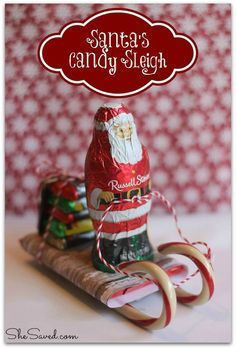 Santa Candy Sleigh Christmas Craft What a fun way to announce Santa's arrival with this load of sweet treats! This cute Santa Candy Sleigh Christmas craft is made entirely of edible goodness makes a great package topper, gift for classmates or teacher.
