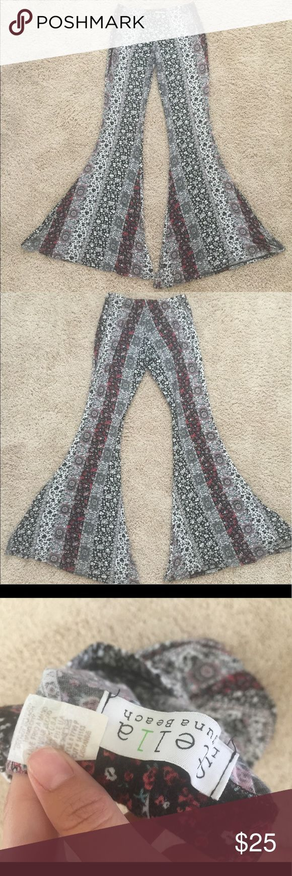 Bell Bottoms, Stella Laguna Beach Bell Bottoms, Stella Laguna Beach brand. Only worn a few times, still in good condition. They are long, I am 5'7 and they hit the floor 👍🏼 size L, stretchy though so someone smaller or bigger can fit in them Stella Laguna Beach  Pants Boot Cut & Flare