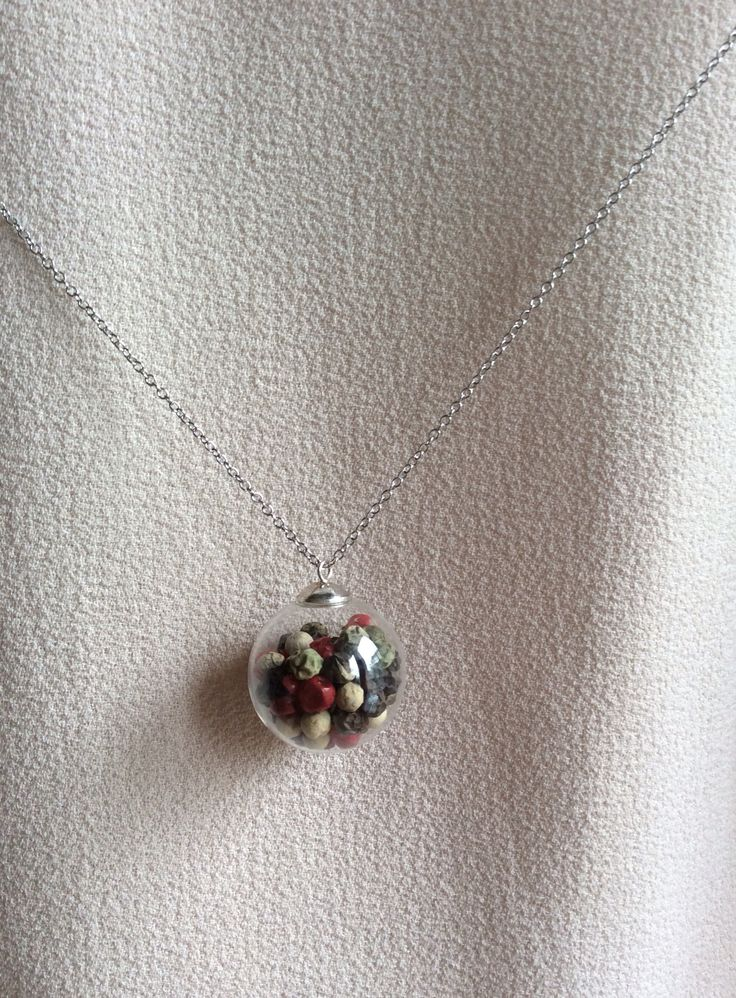 25 mm glass bubble orb pendant on a long silver plated necklace - filled with 4 colored pepper. Giranelli design jewelry
