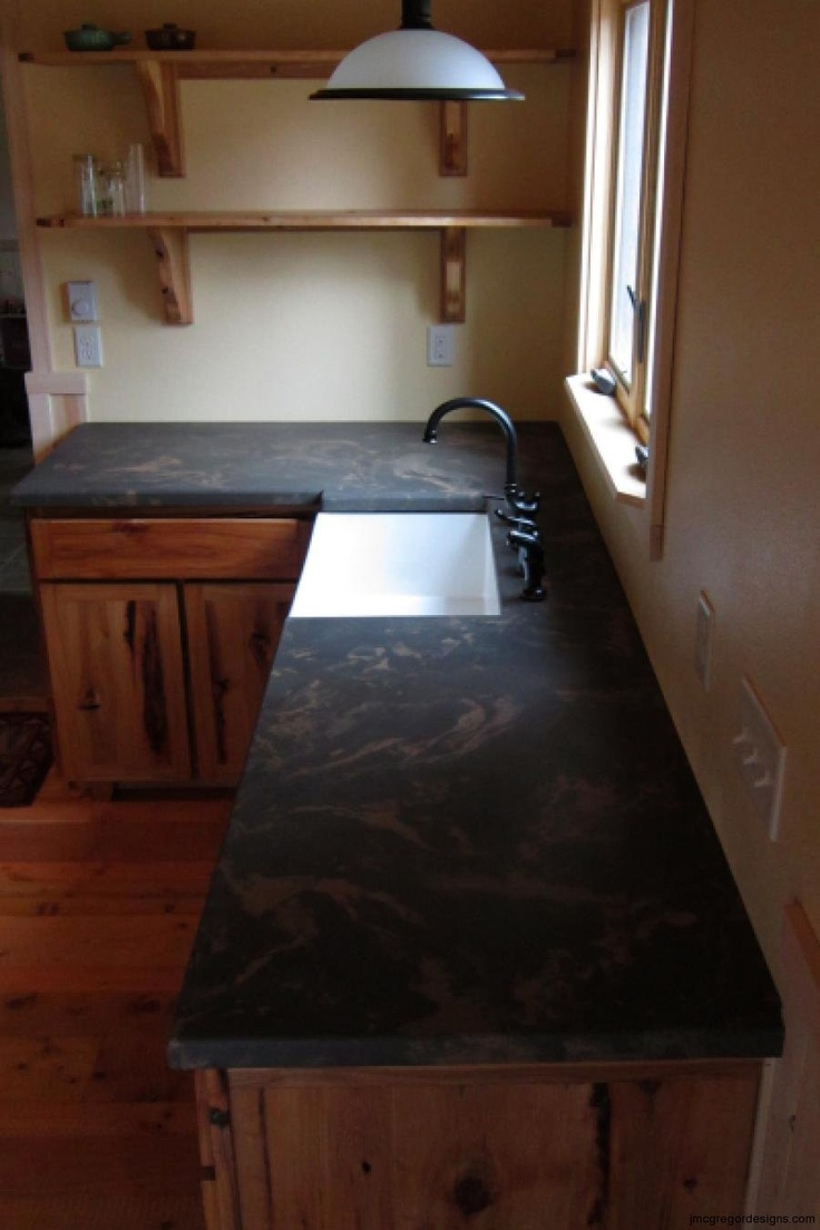 Cabin Kitchen Concrete Counter, under-mount farm style sink, variegated slate grays and earth tones, square front edge...done by artisan James McGregor with McGregor Designs