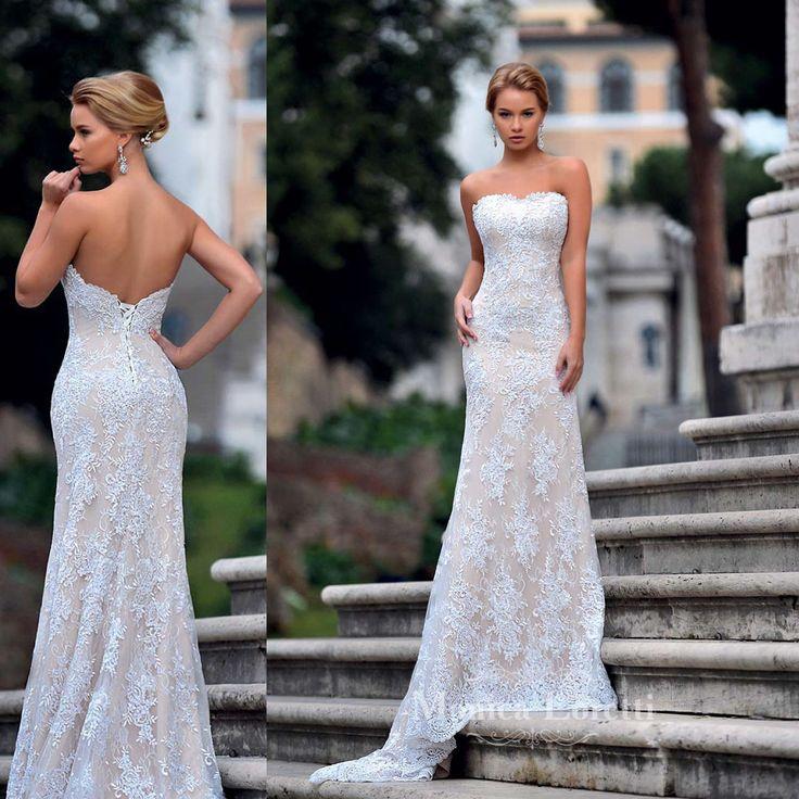 Bellissimo abito da sposa a sirena in pizzo bianco articolo Livia Monica Loretti