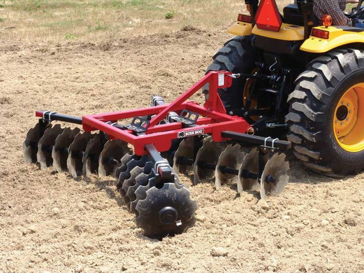 Useful tractor attachments such as the earth auger, rear-mounted blade, rotary tiller and more ...