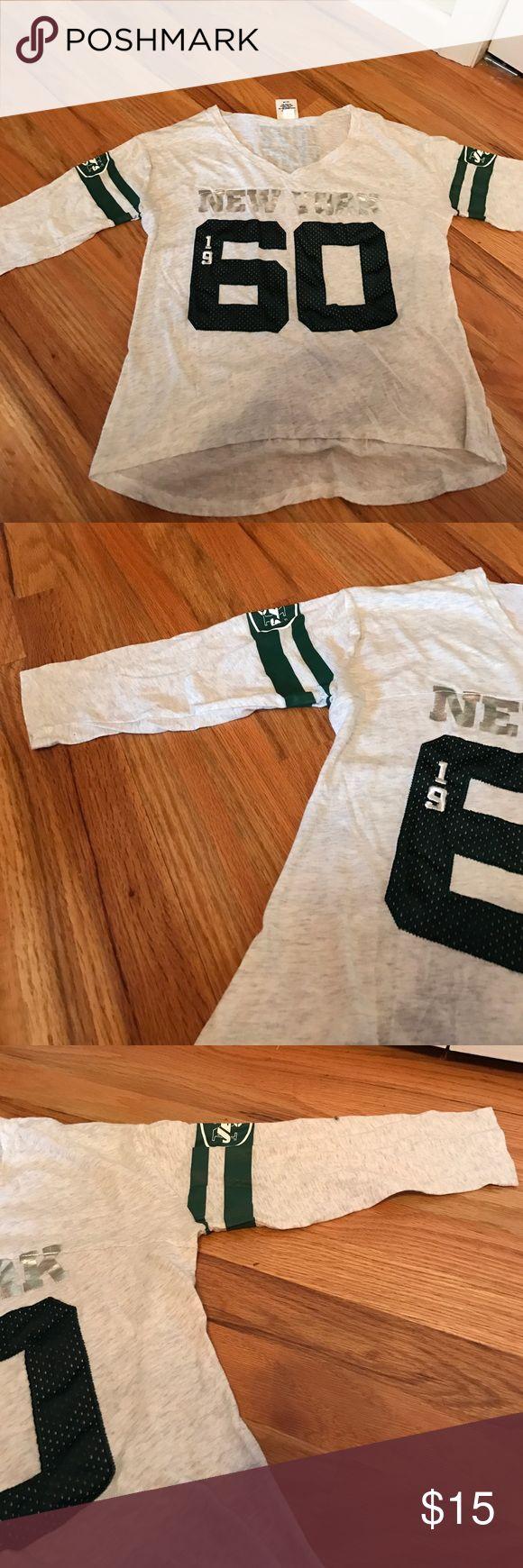 Three quarter length PINK NFL Jets shirt. Three quarter sleeve PINK NFL Jets shirt. Size Medium, worn once. PINK Victoria's Secret Tops Tees - Long Sleeve