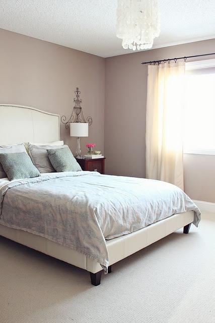 Master bedroom - white headboard, tan walls