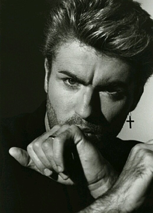 George Michael. Looking at him makes me happy. I don't care if he is Gay, I'd still have his Baby! <3