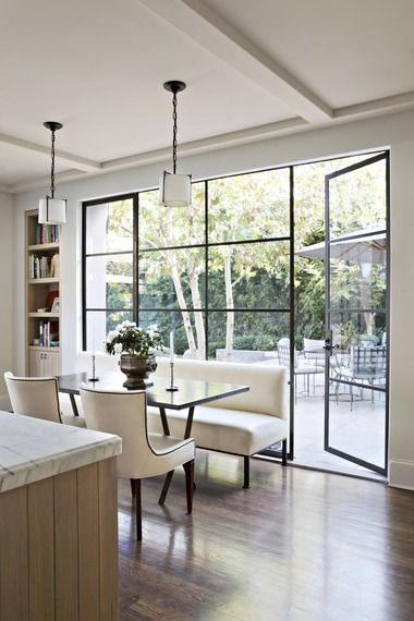 Open plan kitchen with modern styled french doors and an island behind
