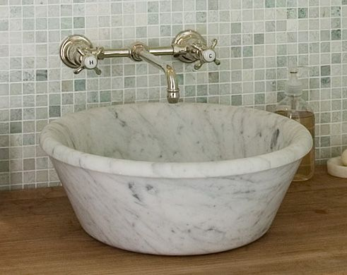 I'm normally not a vessel-sink person, but DAMN that's gorgeous.  I just want to touch it.