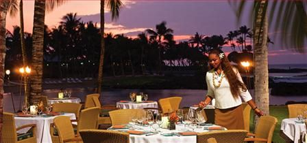 Brown's Beach House at the Fairmont Orchid is one of the most romantic restaurants in the world. Located outdoors just steps from the ocean, the food & service are impeccable. And you will be serenaded by peaceful island music. Truly a special-occasion meal. goinformed.net