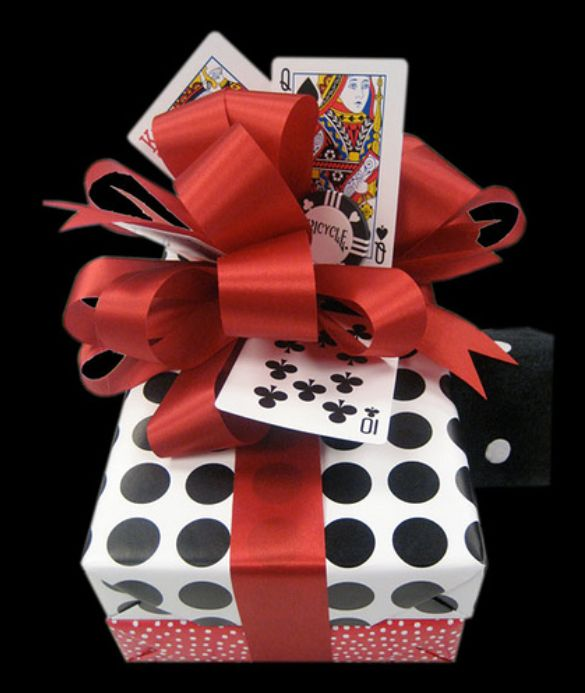 Vegas Themed Gift: Playing cards used to decorate gift... great idea for the poker-playing man.