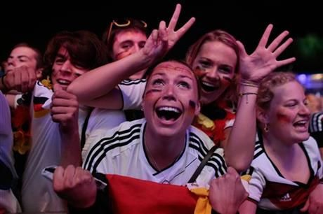 German soccer fans celebrate after their team won the Brazil World Cup semi final being played in Belo Horizonte, Brazil, between Germany and Brazil at a public viewing event called 'Fan Mile' in Berlin, Tuesday, July 8, 2014. (AP Photo/Markus Schreiber) ▼9Jul2014AP Germany delighted, astonished by Brazil rout http://bigstory.ap.org/article/germany-delighted-astonished-brazil-rout #Brazil2014 #Brazil_Germany_semifinal #Berlin