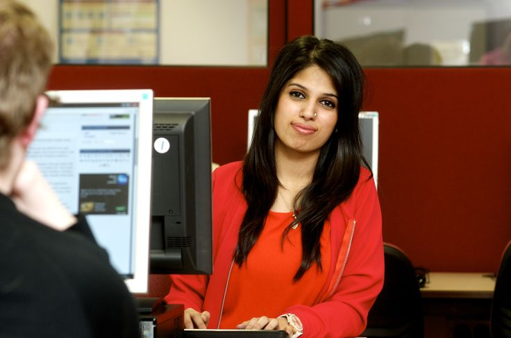 An ICT student enjoying her course, making sure her work is all up to date.