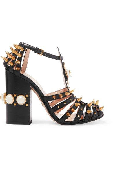 Gucci gives the timeless Mary Jane pump an edgy update, designing this caged leather pair with edgy cutouts and spiked studs. From the label's Pre-Fall '16 collection, this Italian-made style is embellished with a gold-tone metal flower and plush faux pearls that are topped with the signature 'GG' emblem. Reference the brand's eclectic feel and team yours with a boldly printed dress.