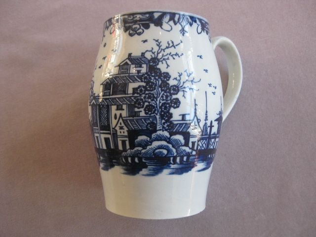 A quart size Liverpool pearlware mug.Brightly painted in blue with Chinese buildings  and a tree to the front and a sailing boat to the back. Unmarked   Circa 1770