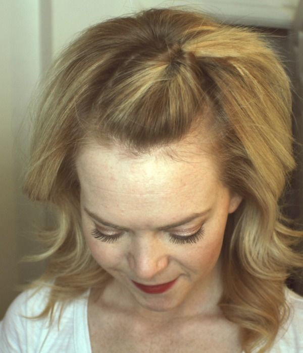Loop Knot. a cute easy way to pull back your bangs.