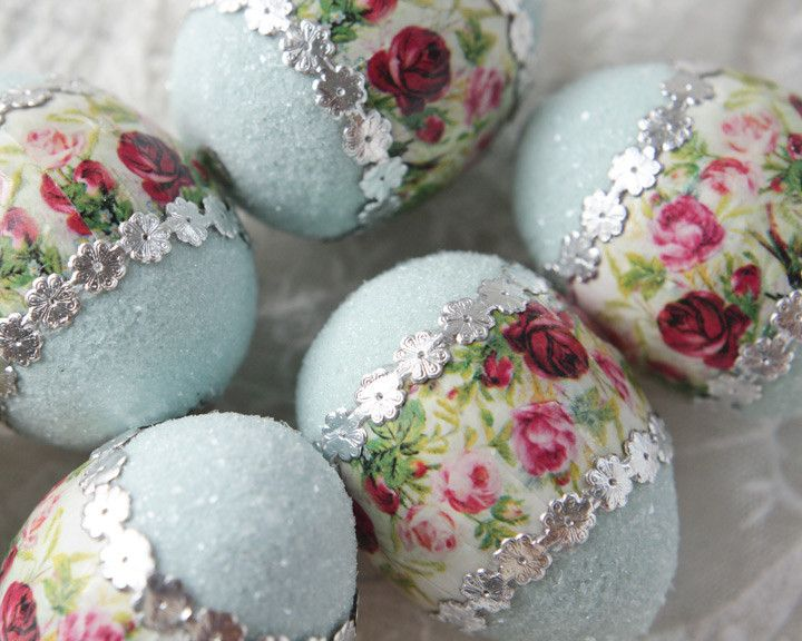 Floral Easter Egg - Blue Spun Cotton Egg Decoration A lovely handmade floral Easter egg. This egg is made of spun cotton decorated with blue paint, german glass glitter, silver Dresden paper trim, and