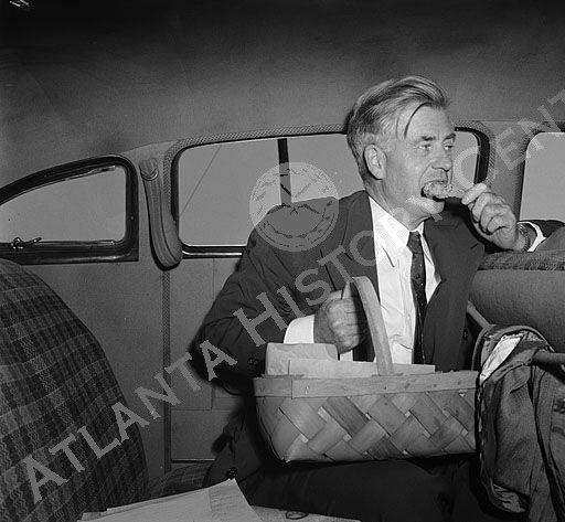 View of Progressive Party presidential candidate Henry Wallace eating while on a campaign tour in the South. Henry Wallace served as Secretary of Agriculture from 1933-1940, Vice President of the United States from 1941-1945 and Secretary of Commerce from 1945-1946. Wallace was also the Progressive Party nominee for the 1948 presidential election. Atlanta History Center.