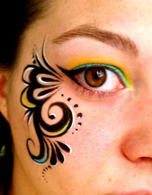 Swirly girly face paint by Kara Mundy