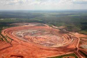 Catoca pit, Angola. Angola's largest mine produced 6.5 million carats 2012 from 10 million metric tons of ore, generating revenue of $575 million  Catoca is owned by Angola's state-owned diamond company Endiama which holds a 32.8 %. Alrosa of Russia also has 32.8 %, a venture between China and state oil producer Sonangol owns 18% and Odebrecht SA of Brazil has 16.4%.