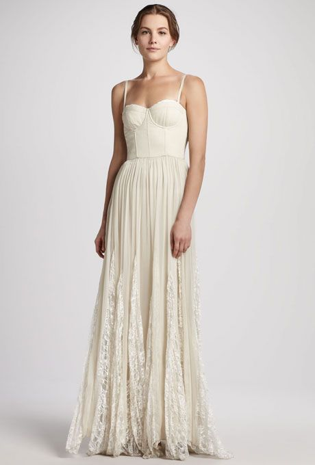 """Brides.com: Wedding Dresses We Love For Under $1,000. For a boho bride who craves a dash of sex-appeal, the bustier bodice on this lightweight, pleated maxi dress will up the va va voom factor.  """"Geneva"""" bustier pleated maxi wedding dress, $597, Alice + Olivia available at Neiman Marcus  See more spaghetti strap wedding dresses."""
