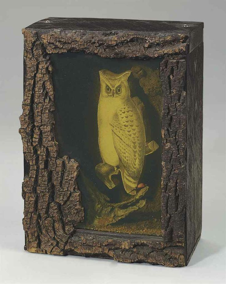 Joseph Cornell (1903-1972)  Untitled (Owl Habitat)  signed 'Joseph Cornell' (on a paper label affixed to the reverse)  wood box construction--bark, glass, printed paper collage, wood shavings, adhesive and nails 11¼ x 8¼ x 5 1/8 in. (28.5 x 20.9 x 13 cm.)  Executed circa 1948-1950.