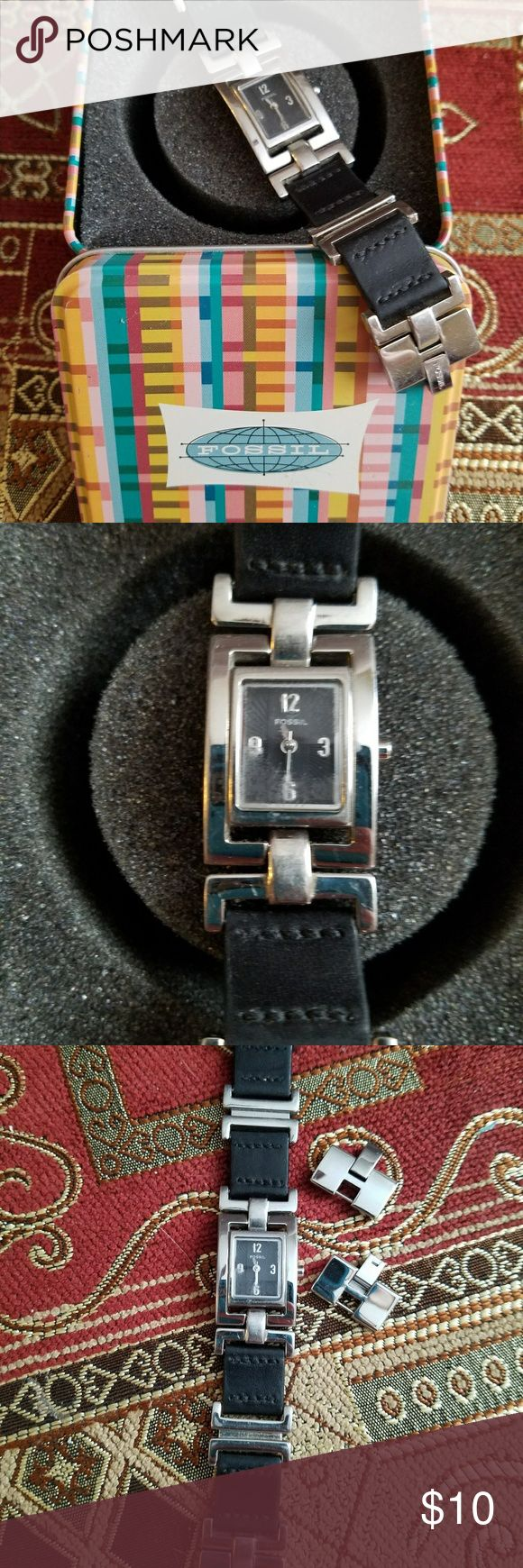 Women's Fossil Watch Women's Fossil Watch with black leather and silver link band and black face with silver numbers. Has additional links to extend the size of the band. Glass on face has stuffing. Well loved but still a great watch. Needs a new battery. Smoke free, pet friendly home. Fossil Accessories Watches
