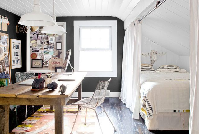 The industrial-looking curtain rods surrounding the guest bed in this Pennsylvania home are actually made from old electrical piping.   - CountryLiving.com