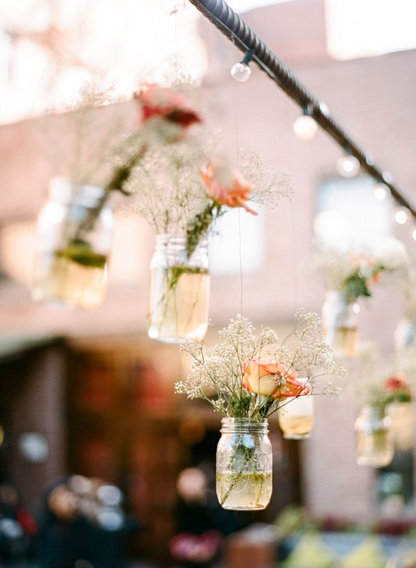 hanging flower decor - photo by Rebecca Yale Photography http://ruffledblog.com/intimate-and-personal-wedding-at-mymoon