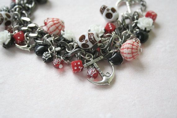 $29.95 OOAK Anchor SkullCharm Bracelet / Day of the Dead Charm Bracelet / Black, Red and White Anchor, Skull and Dice Charm Bracelet - Smitten Kitten Jewelry Handmade Simple, Bridal, Flower, Skull & Anchor Jewelry by Kendall McCulloch. Vintage, Casual, Nautical, Burlesque, Steampunk, Minimalist, Day of the Dead, Rockabilly, Sugar Skull & OOAK Jewelry.  Website: www.smittenkittenjewellery.com Facebook: http://www.facebook.com/pages/Smitten-Kitten-Jewellery/136446979855955