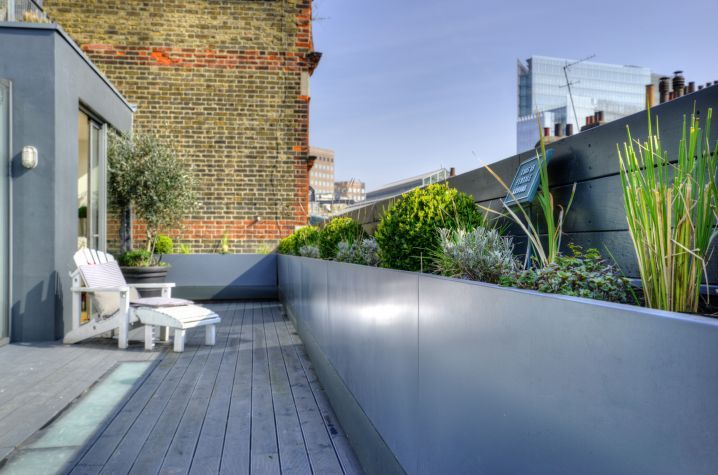 Bespoke powder coated steel trough planters at a private residence in Borough Market