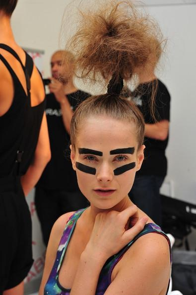 The models at IVANAHelsinki were given a very bare face to allow the giant black stripes on their eyebrows and underneath their eyes to take center stage.