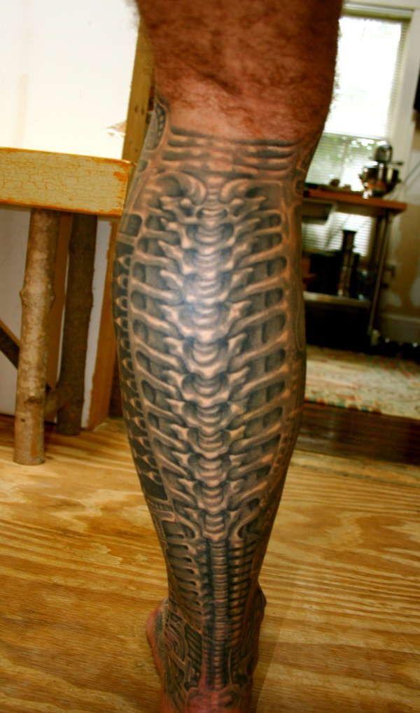 mechanical tattoo, spine, leg - cute-tattoo