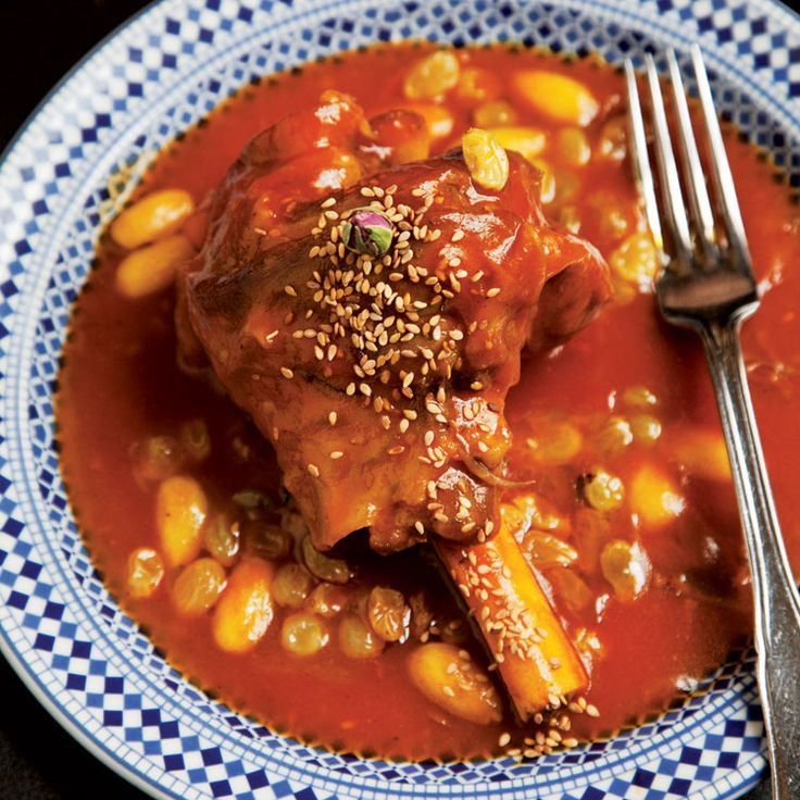 Lamb shanks are braised for hours in a sumptuous sauce of honey, almonds, and raisins in the centuries-old Moroccan dish mrouzia.