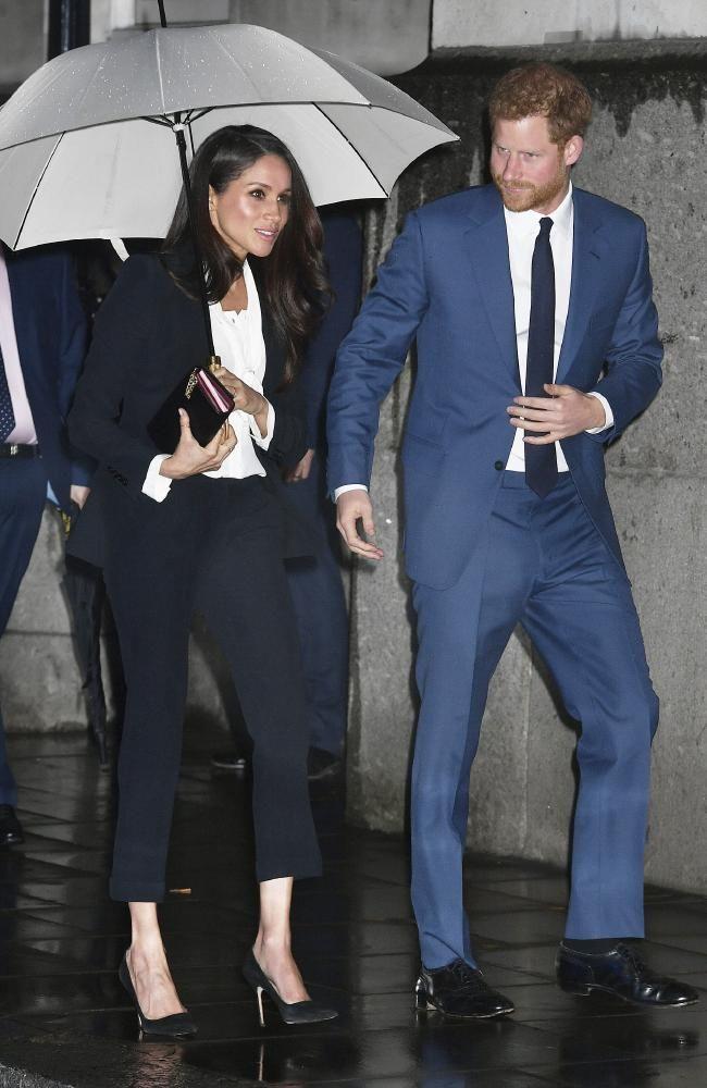 Download Meghan Markle Prince Harry Rain Photo