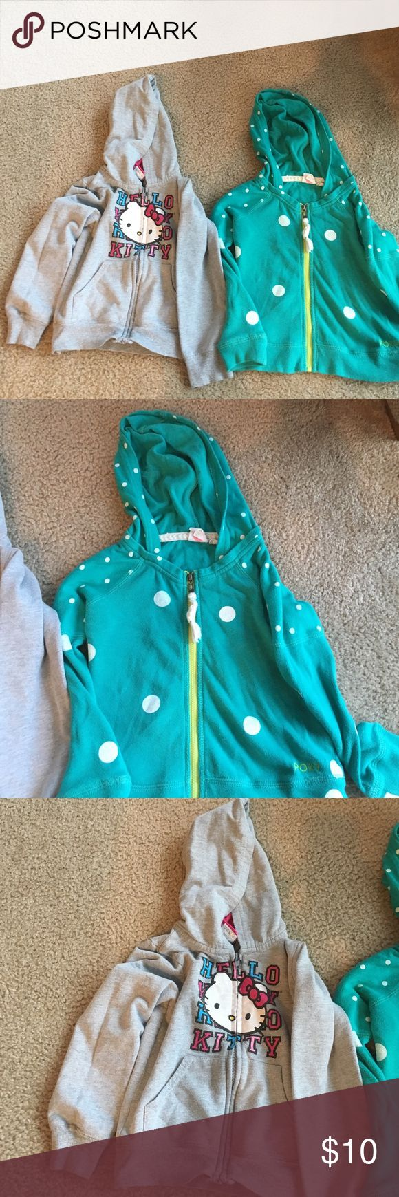 Two zip up hoodies Two zippered hoodies one Roxy teal with white polka dots light material size 4T hello kitty grey size 5T both are in great condition general wash and wear Roxy Jackets & Coats