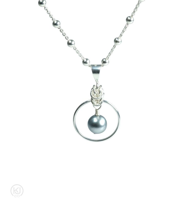 """Aylin – Byzantine Pearlized Drop Agate Necklace – Chic sophistication would be the best way to describe this beautifully appointed necklace from the delicate 3mm ball chain with flat link design to the Byzantine weave holding the Pearlized drop agate pendant with halo ring orbiting around it. Perfect for any event or to add that extra touch to any work outfit. Add the matching Aylin - Byzantine Pearlized Drop Agate Earrings for that added touch to your ensemble.   Sizes:   40.6cm or 16""""…"""