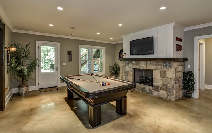 Finished basement entertainment zone with acid washed and sealed concrete floors.