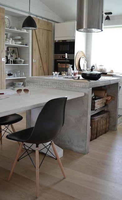 Stoer keukeneiland met betonnen blad. Zwart/wit/grijs/hout.