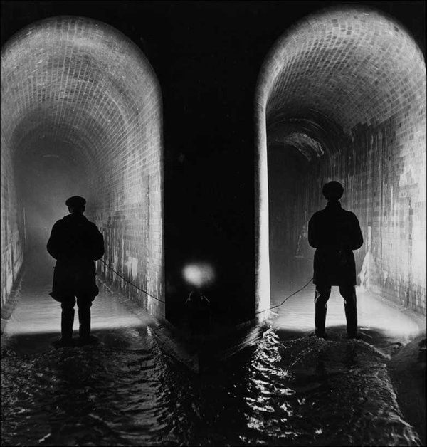 Two sewer workers examine the Fleet sewer, London, at low water level, 1914.  2009. Swine flu blamed for blocked sewers - Telegraph Swine flu is blocking sewers and pumps because people are using more hand wipes and flushing them down toilets, according to Anglian Water.