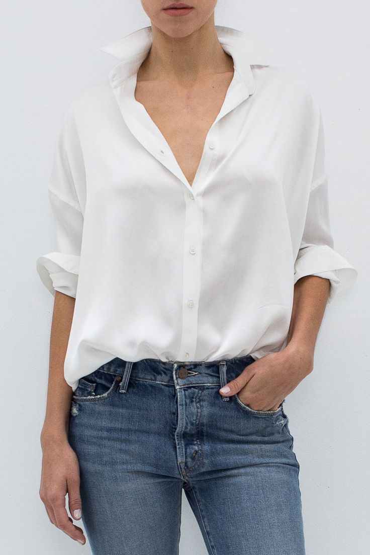 """- 100% Silk - Full button placket with collar - Ivory grosgrain detailed drop shoulders - Long sleeves - Shirttail hem - Color: Ivory - Model is 5'9"""" and wears a size T0."""