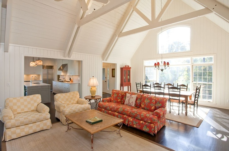 Grand Fireplace W Vaulted Ceilings Beams Open Floor: A Painted Cedar-paneled Great Room Greeting Guests With