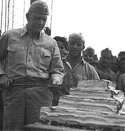 Harry B. Liversedge - Col Liversedge and his Marine Raiders, cutting the cake during their 1943 celebration of the Marine Corps birthday.The Marine Raiders were elite units established by the United States Marine Corps during World War II to conduct special amphibious light infantry warfare, particularly in landing in rubber boats and operating behind the lines.