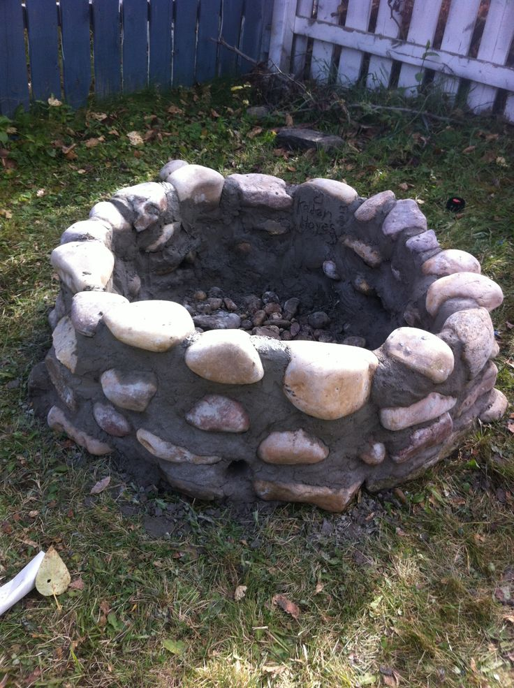 River rock fire pit stone fire pits pinterest fire for How to build a river rock patio