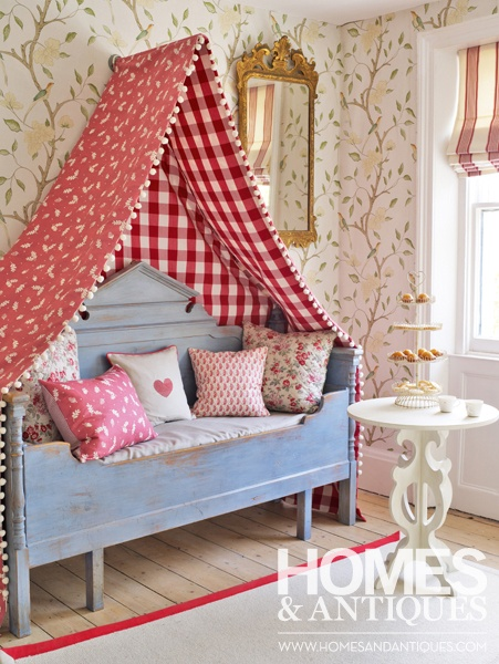 Create a calm corner with an antique Gustavian daybed and canopy.