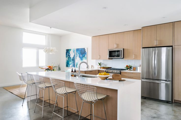 Iconic Bertoia counter stools were chosen to complement the hardware.